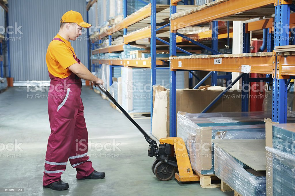 worker with fork pallet truck royalty-free stock photo
