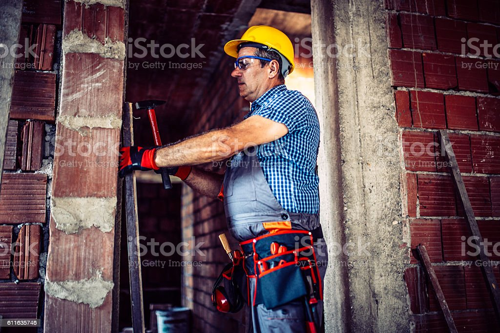 Worker with hammer stock photo