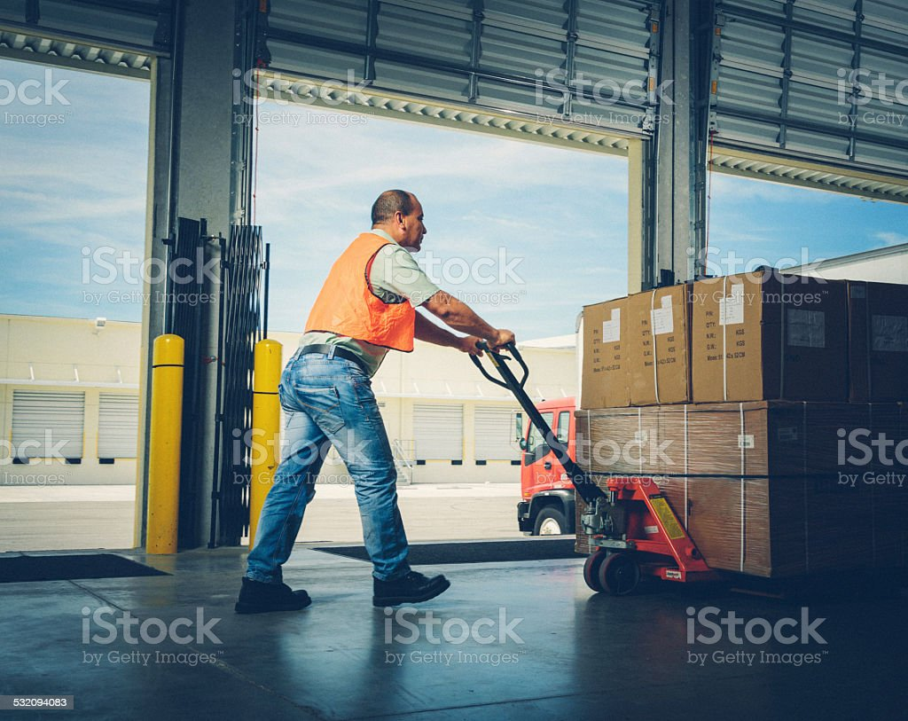 worker with hand pallet truck stock photo
