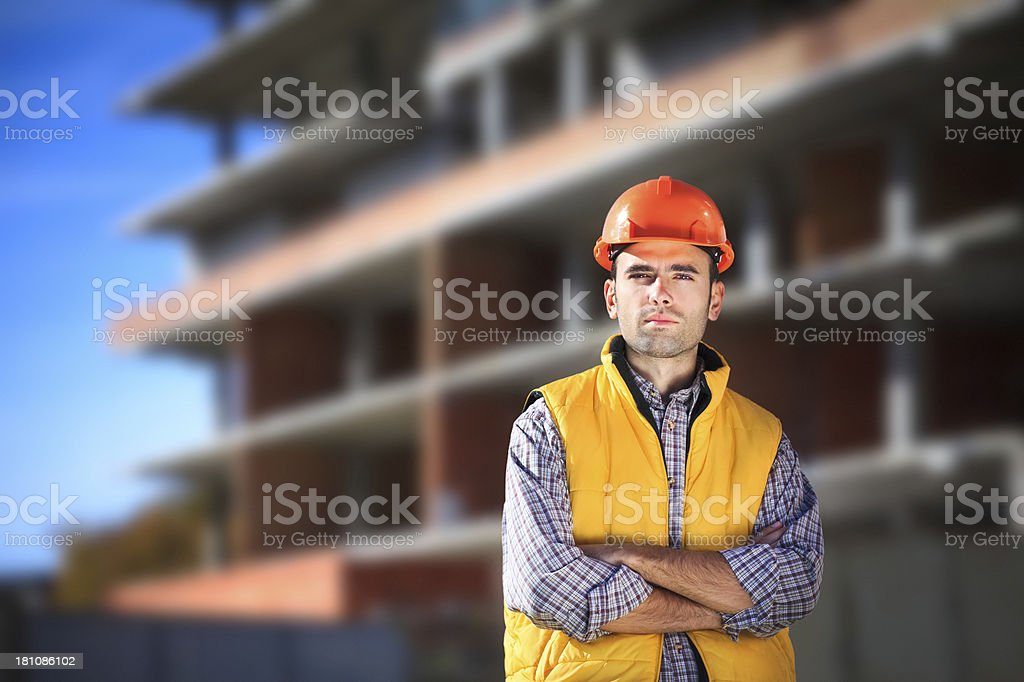 Worker with hard-hat near unfinished building stock photo