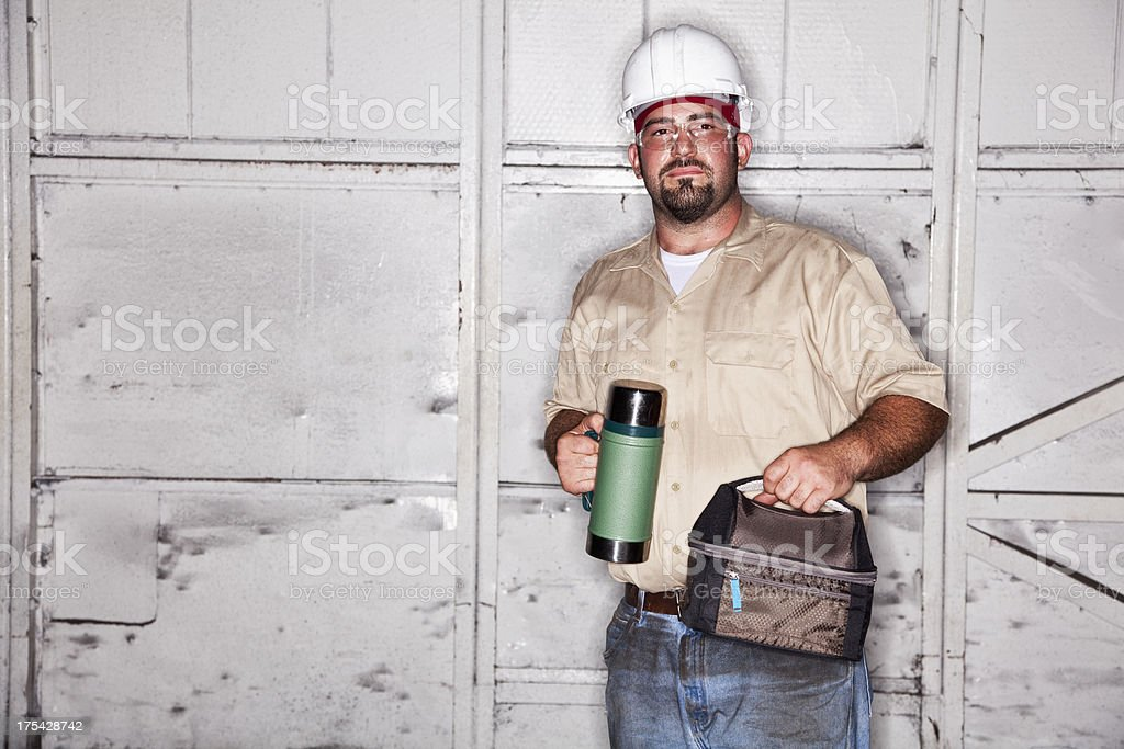 Worker with lunchbox stock photo