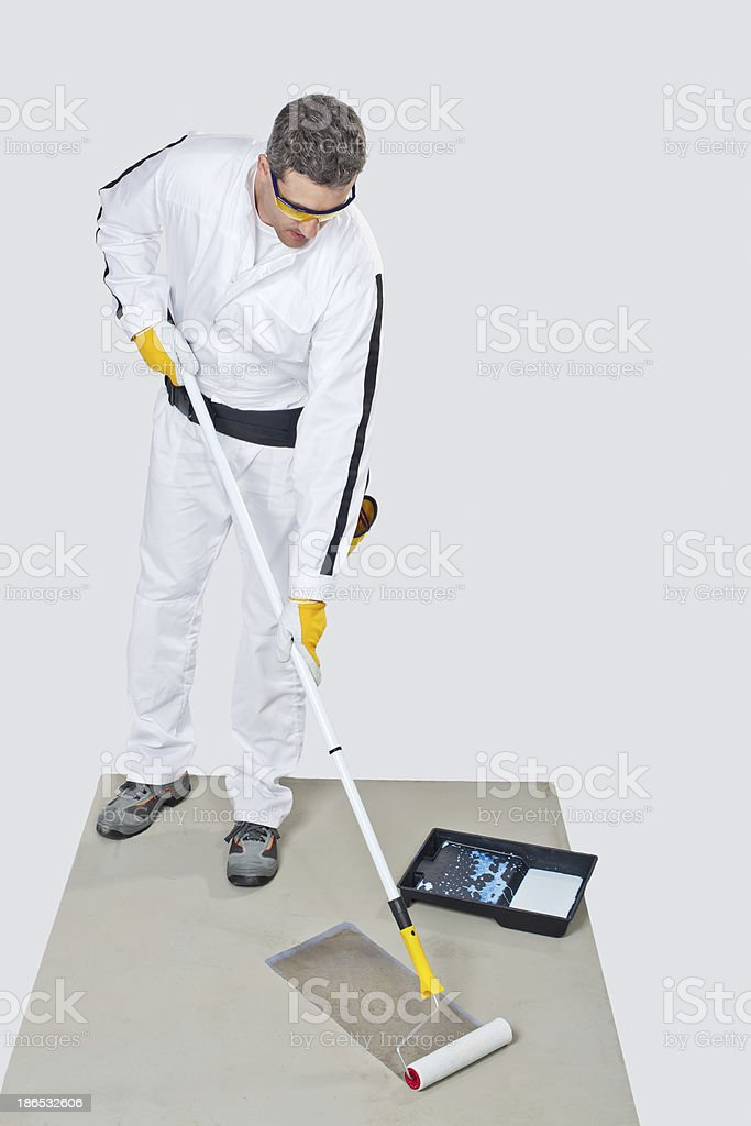 worker with paint roller primed royalty-free stock photo