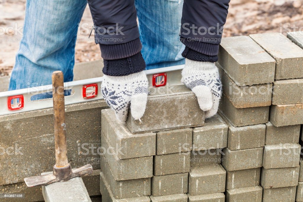 Worker with paving bricks stock photo