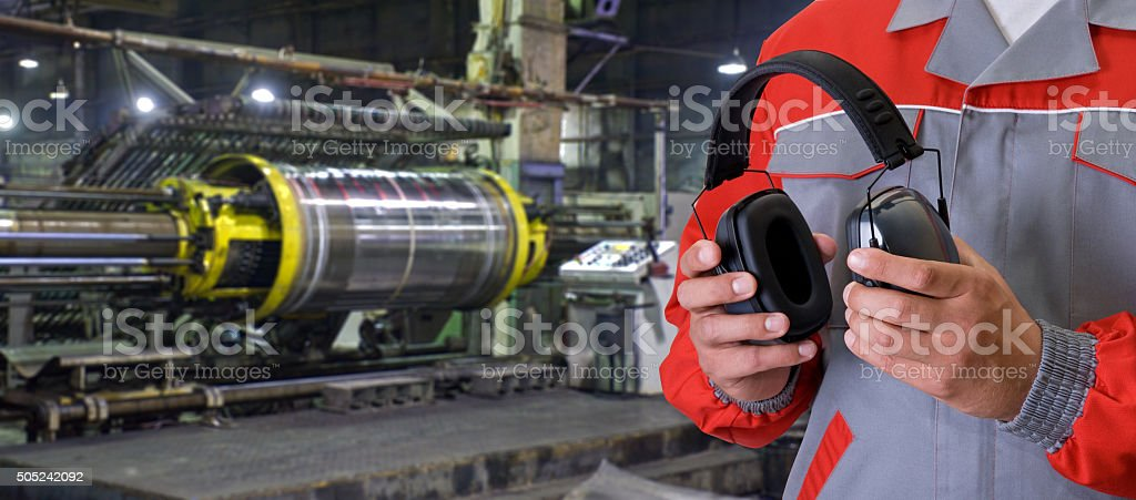 Worker with protective headphone stock photo