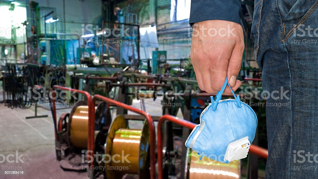 Worker with protective respirator stock photo