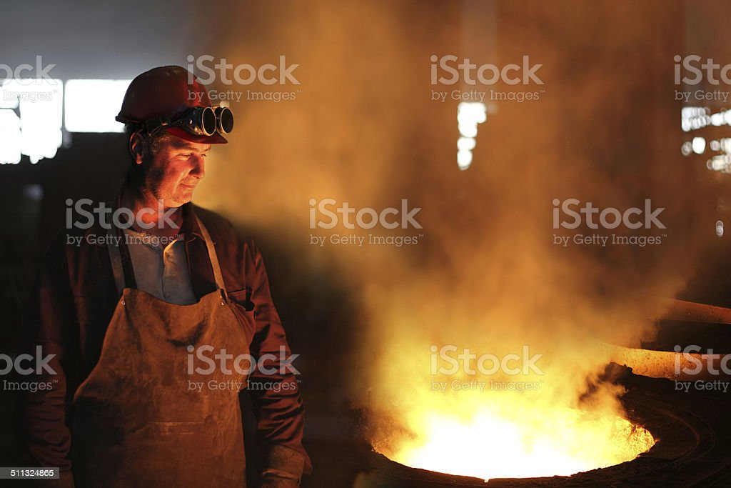Worker with safety goggles in a foundry stock photo