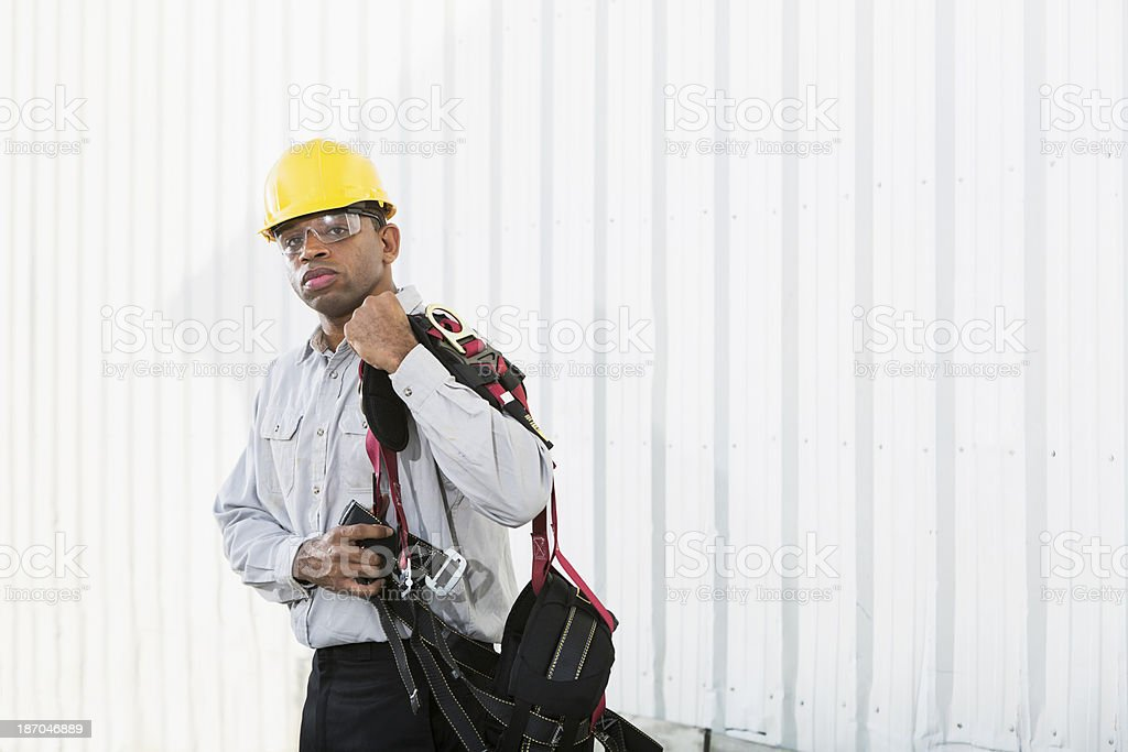 Worker with safety harness stock photo