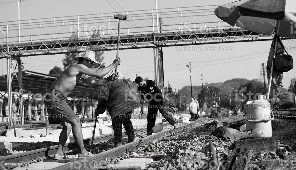 Worker with tools repair rail lines. stock photo