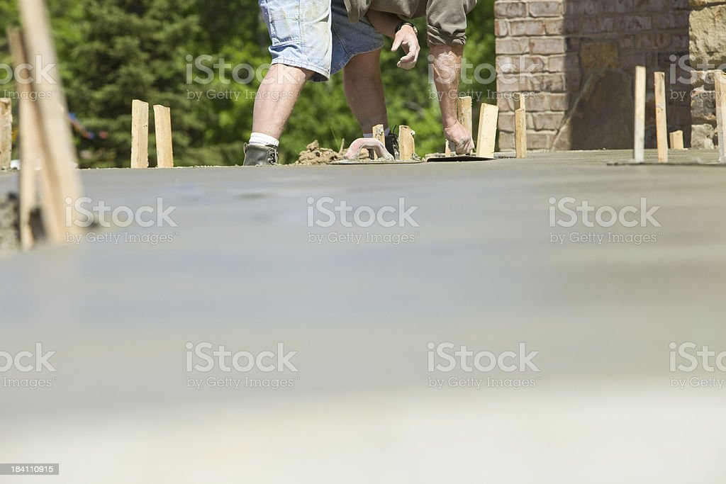 Worker with Trowel Applying an Edge to Concrete Sidewalk stock photo