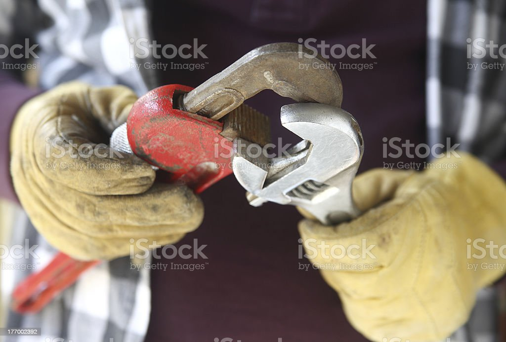 worker with two wrenches royalty-free stock photo