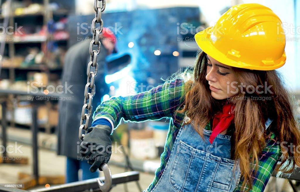 Worker Woman in Workshop stock photo