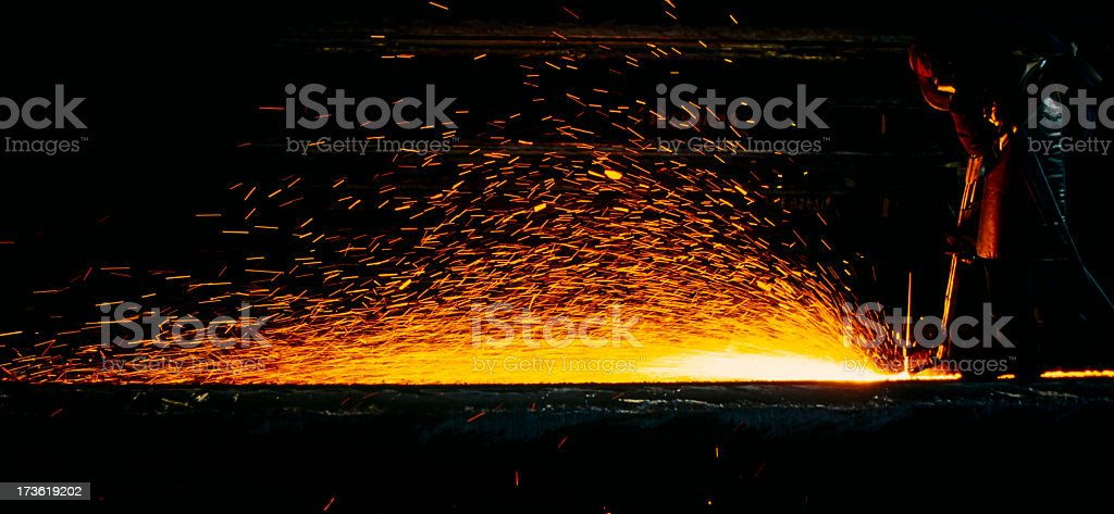 Worker working in metal industry with sparks flying stock photo