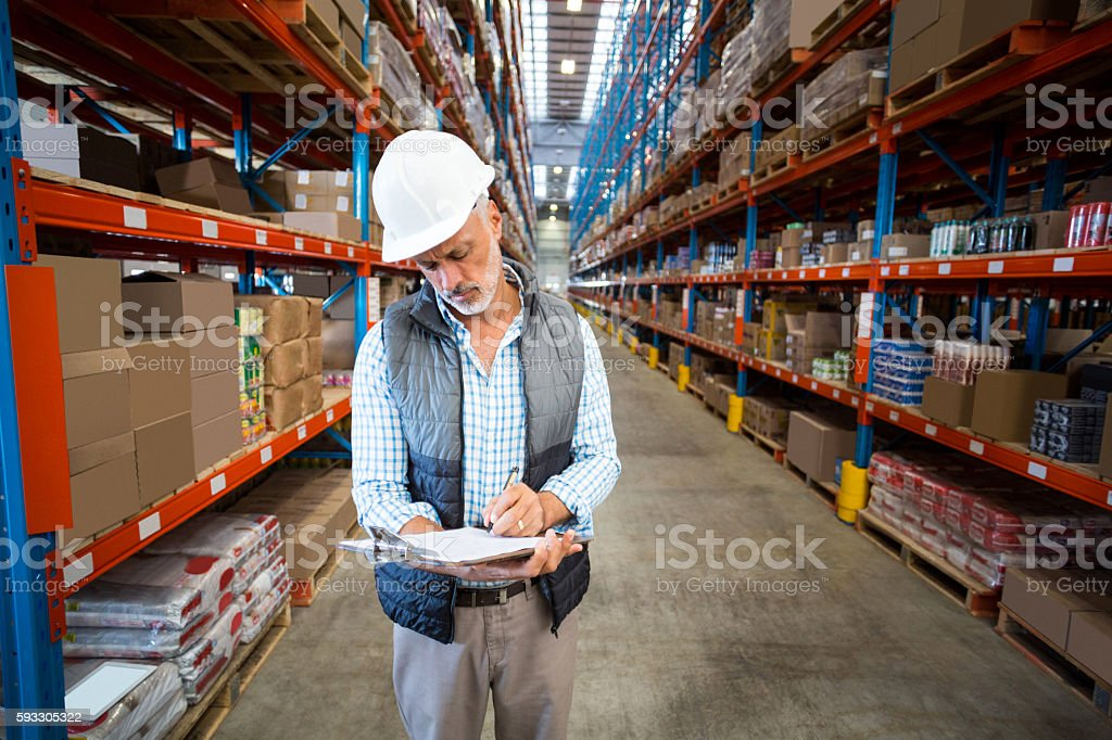 Worker writing on clipboard stock photo