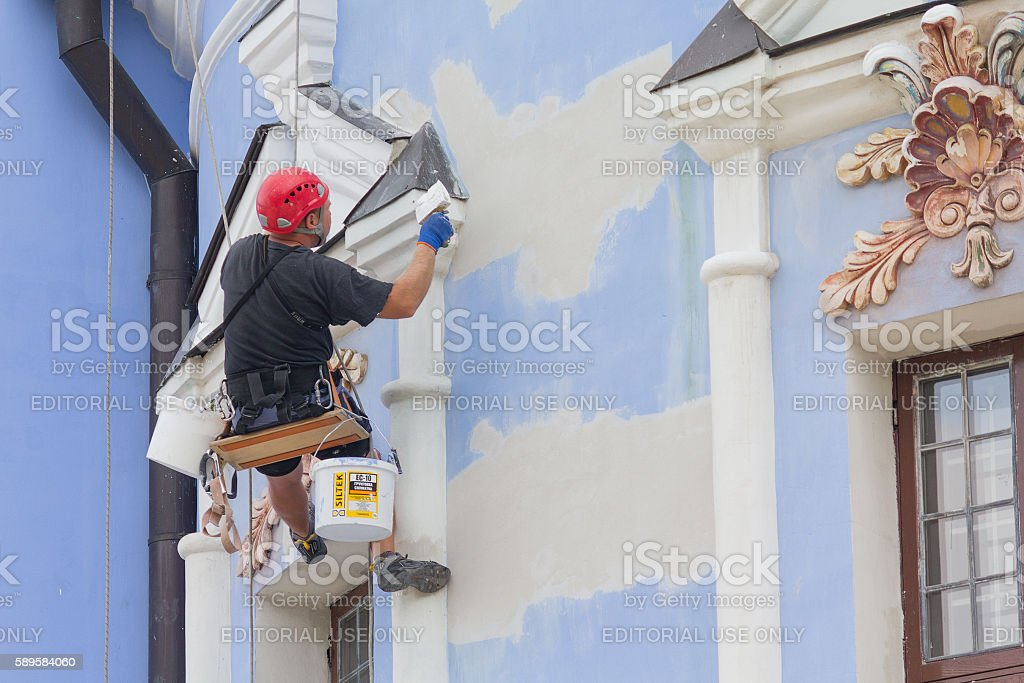 Worker-restorer working at height Repair Michael's Monastery.Kiev, Ukraine stock photo
