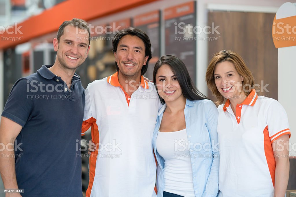 Workers and customers at a furniture store stock photo