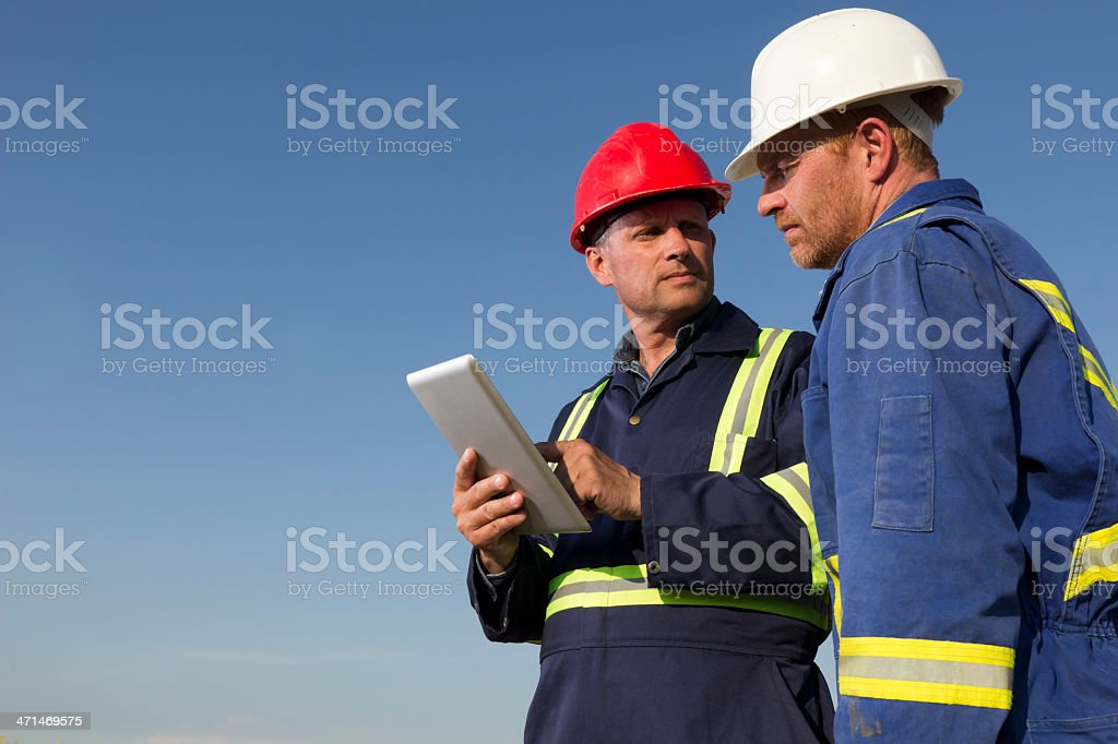 Workers and Tablet stock photo