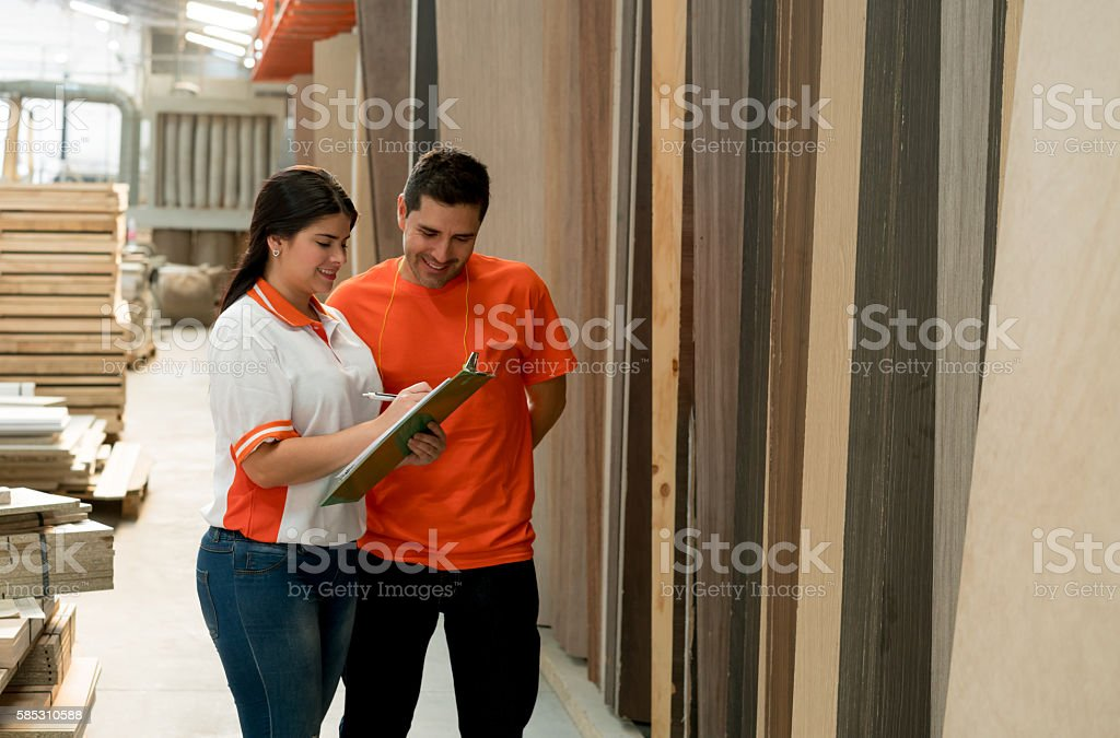 Workers at a lumberyard stock photo