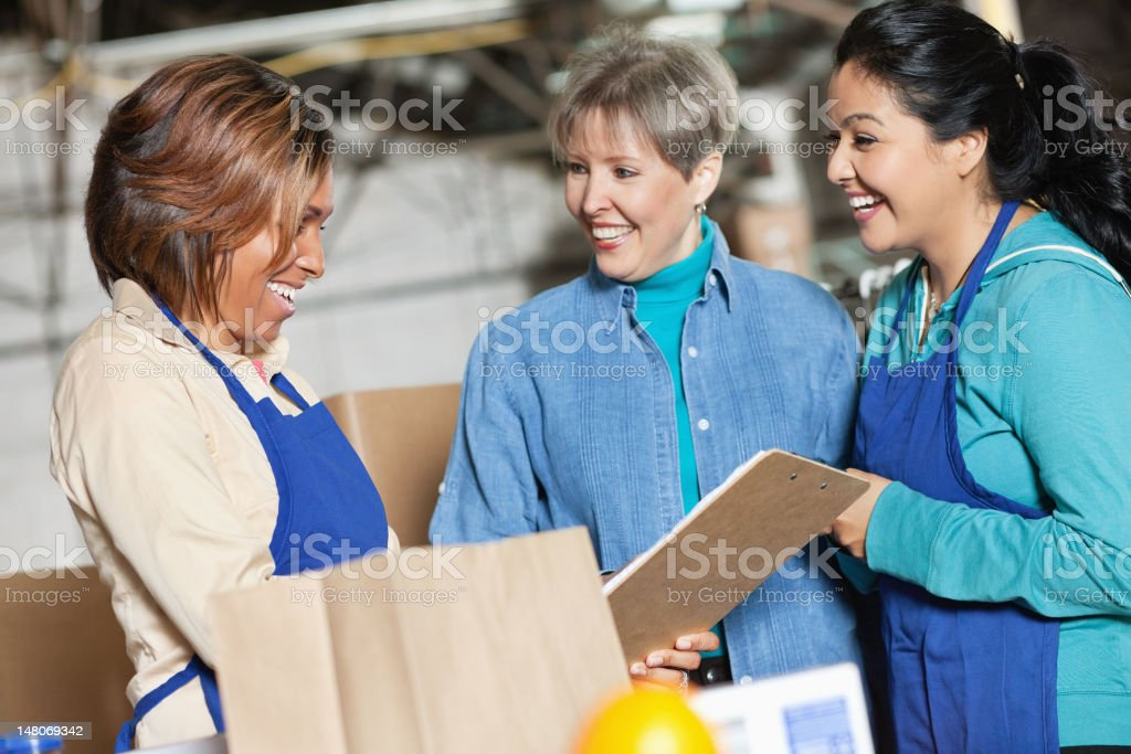 Workers at a plant laughing together royalty-free stock photo