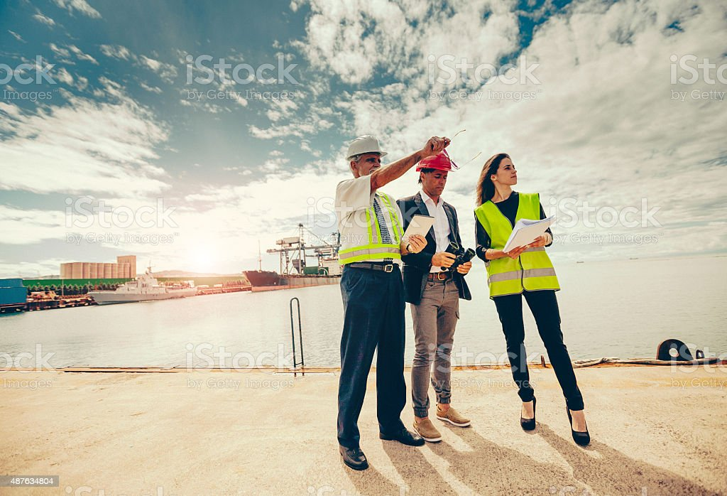 Workers at commercial transport dock stock photo