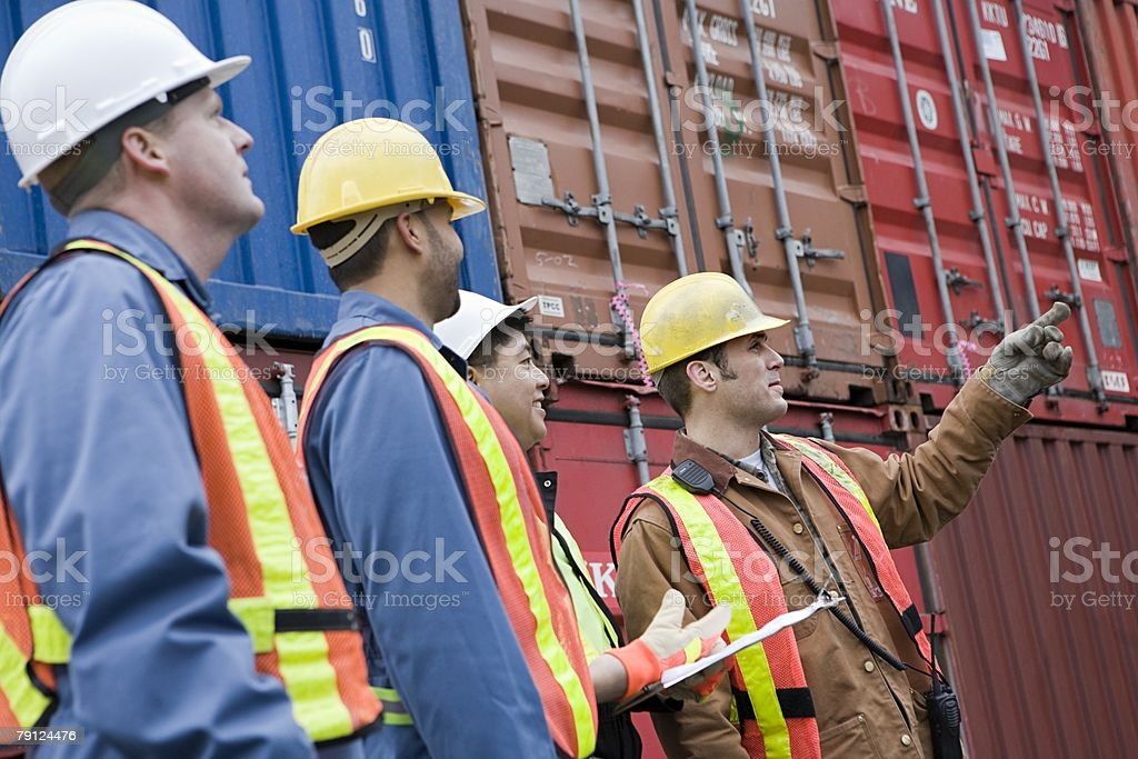 Workers at container terminal stock photo