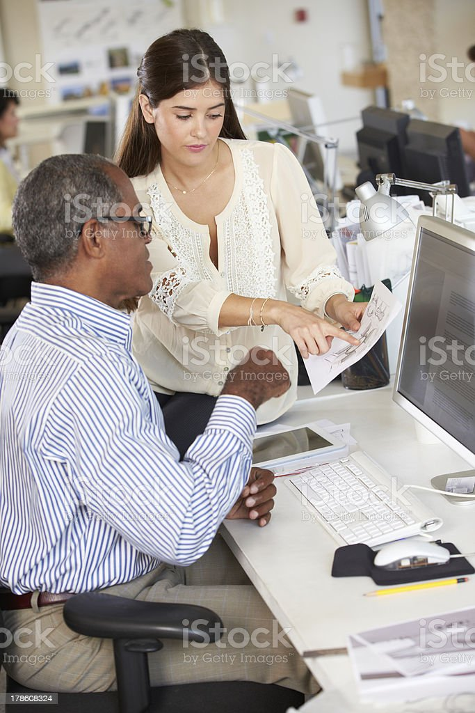 Workers At Desks In Busy Creative Office royalty-free stock photo