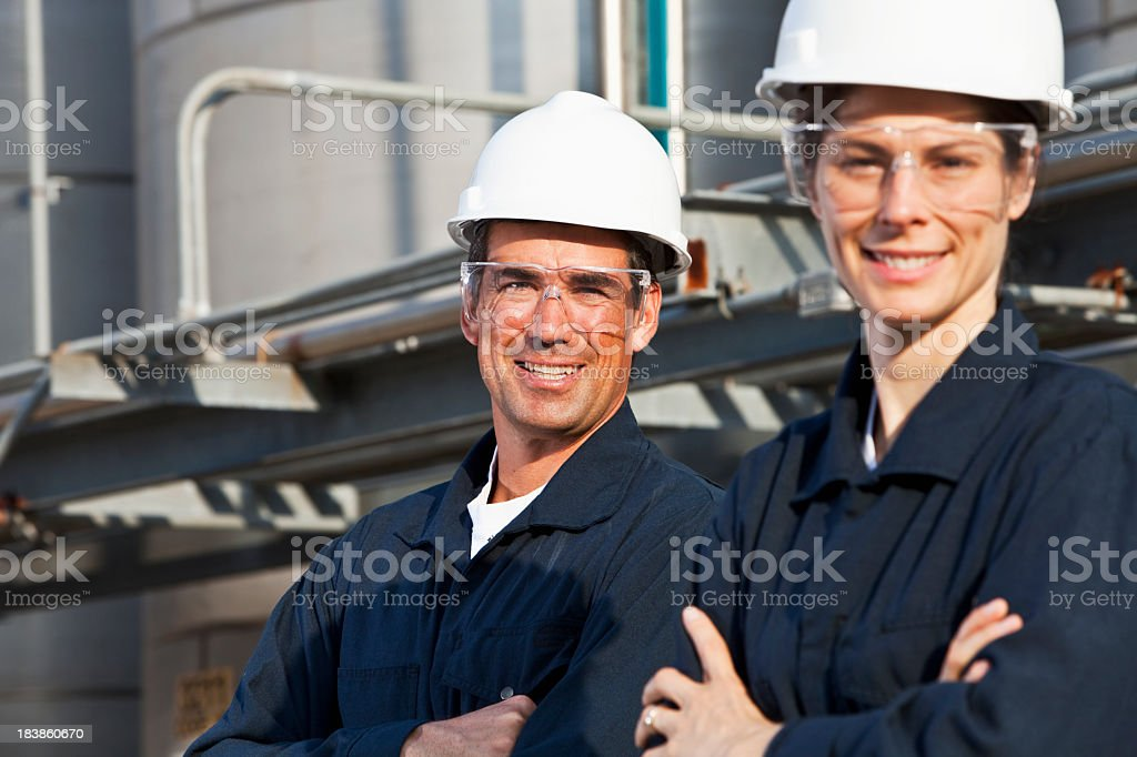 Workers at industrial plant royalty-free stock photo