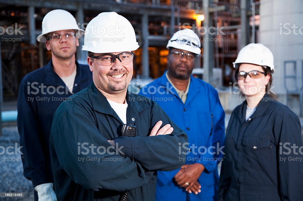 Workers at manufacturing plant stock photo