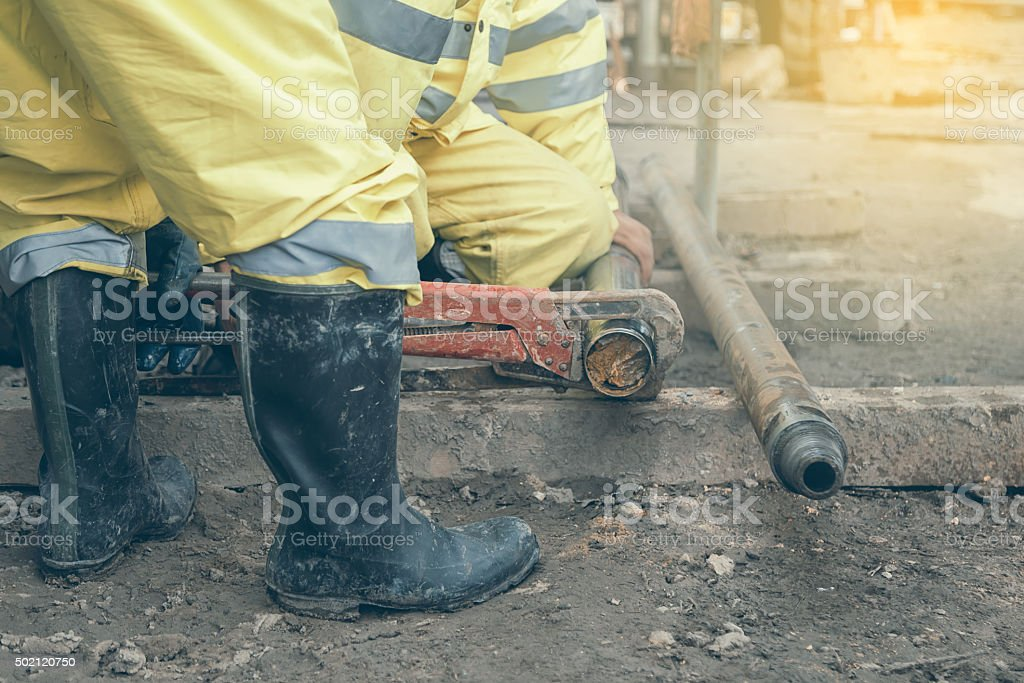 Workers at site take out drill core sample stock photo