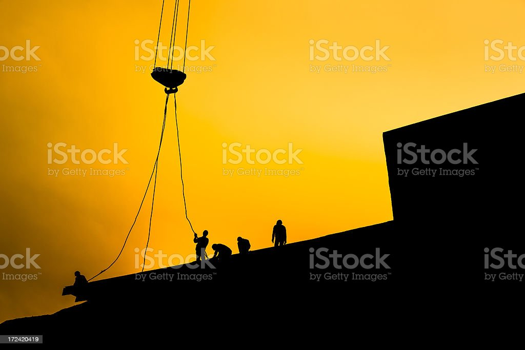 Workers at sunset royalty-free stock photo