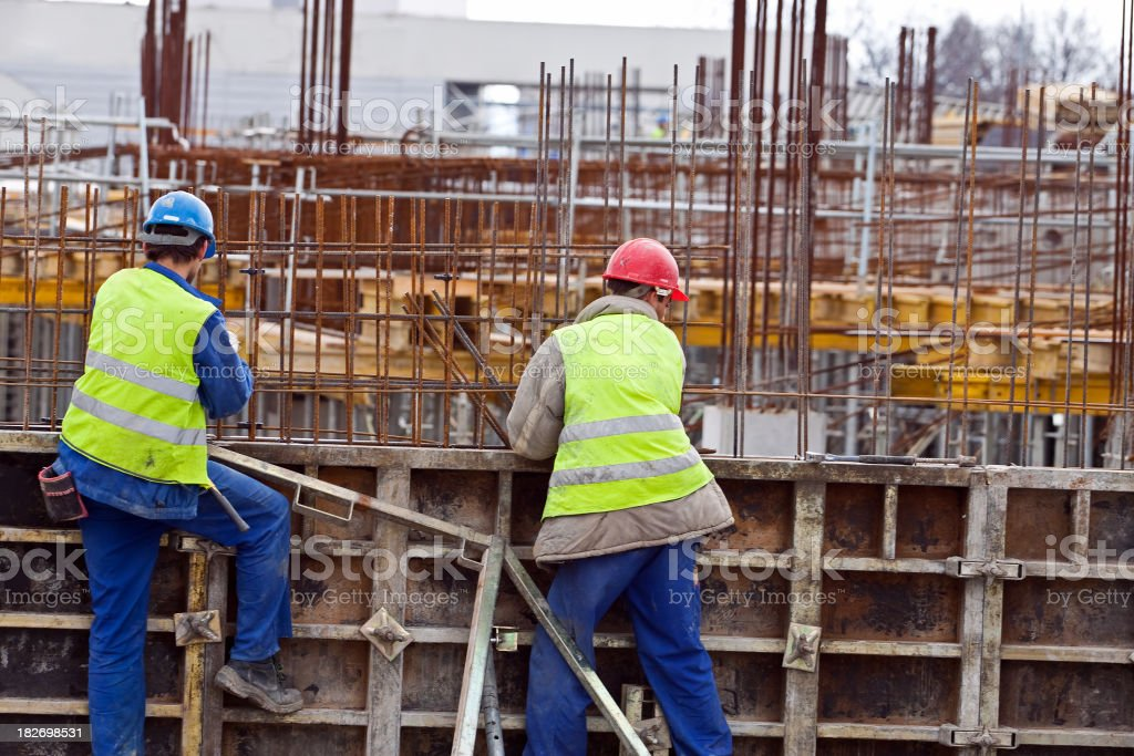Workers at the construction site stock photo