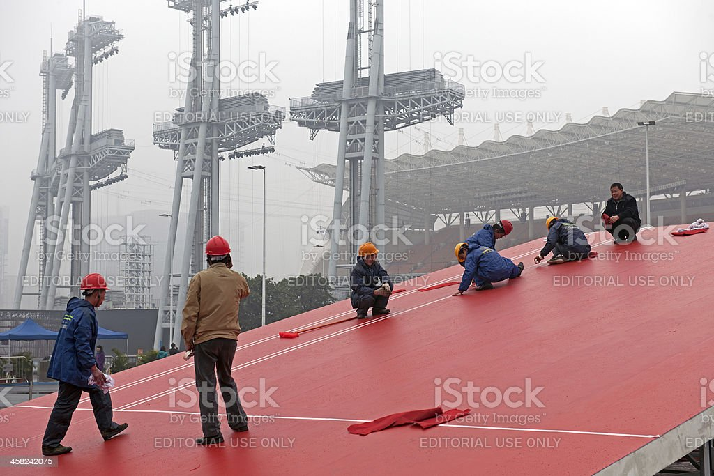 Workers Building Slope for Motorbikes and Cars Guangzhou China royalty-free stock photo