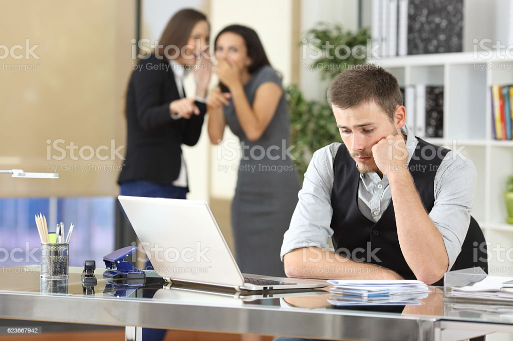 Workers bullying a colleague at office stock photo