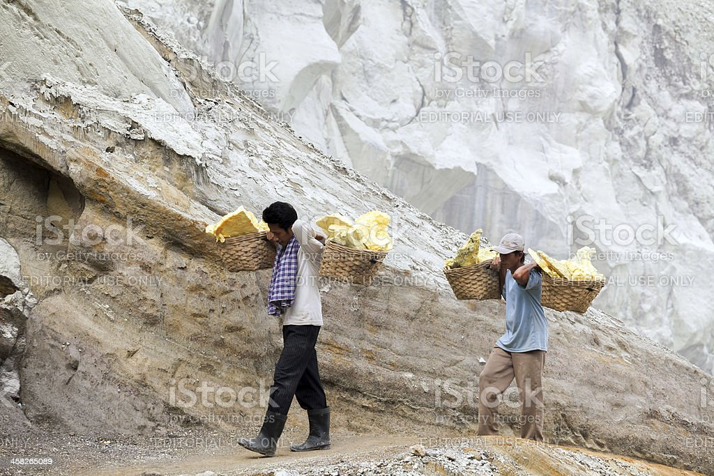 workers carry sulphur royalty-free stock photo