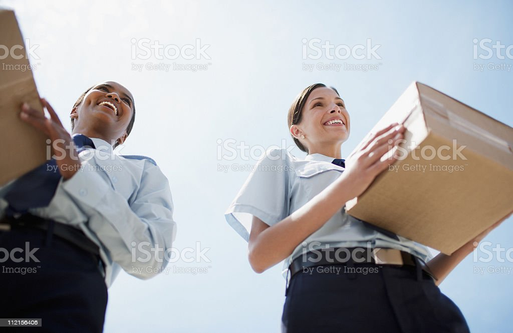 Workers carrying cardboard boxes royalty-free stock photo