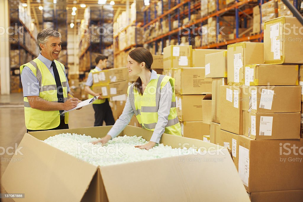 Workers checking box in warehouse royalty-free stock photo