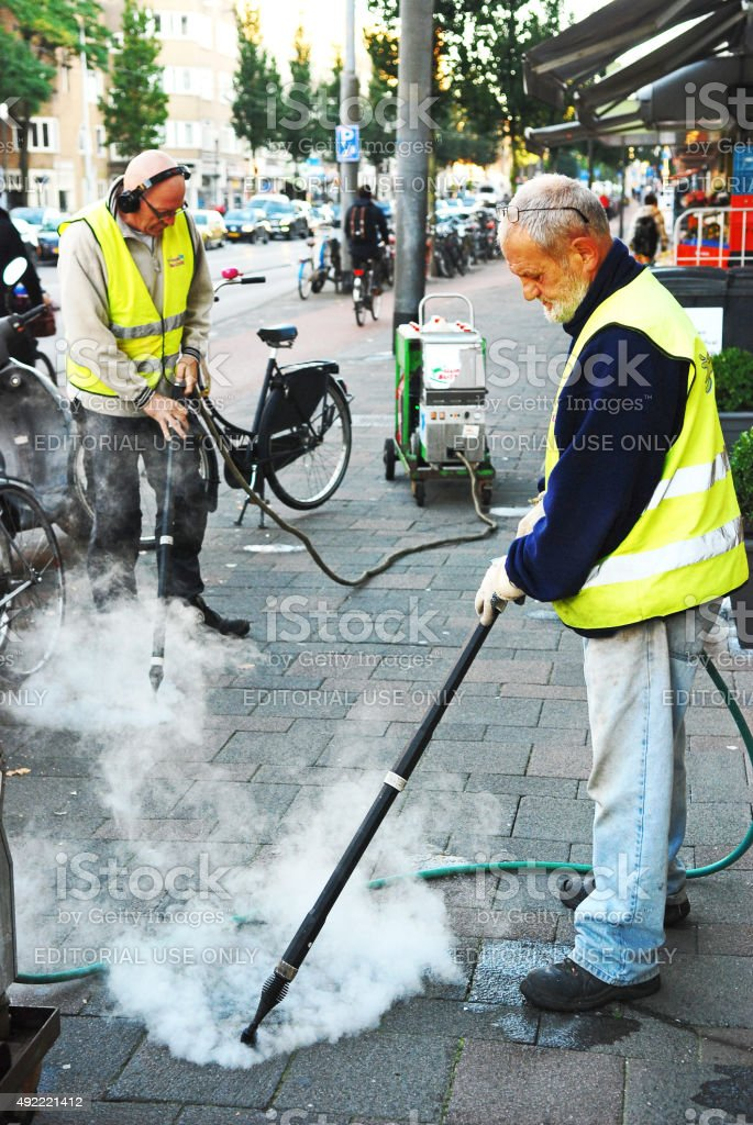 Workers cleaning chewing gum. stock photo
