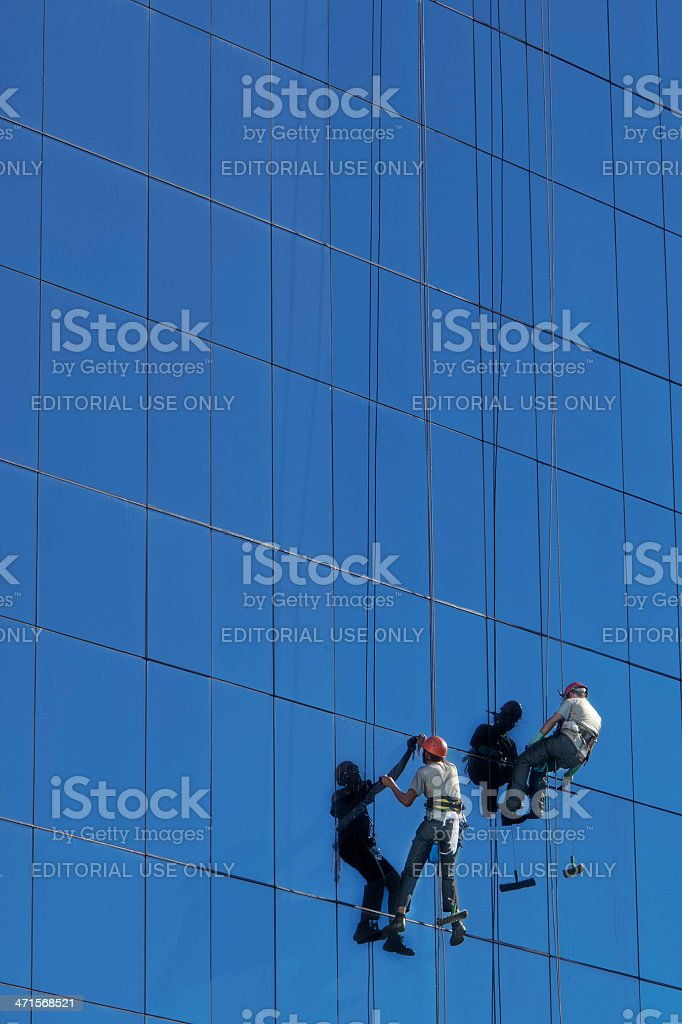 Workers cleaning the building glass royalty-free stock photo