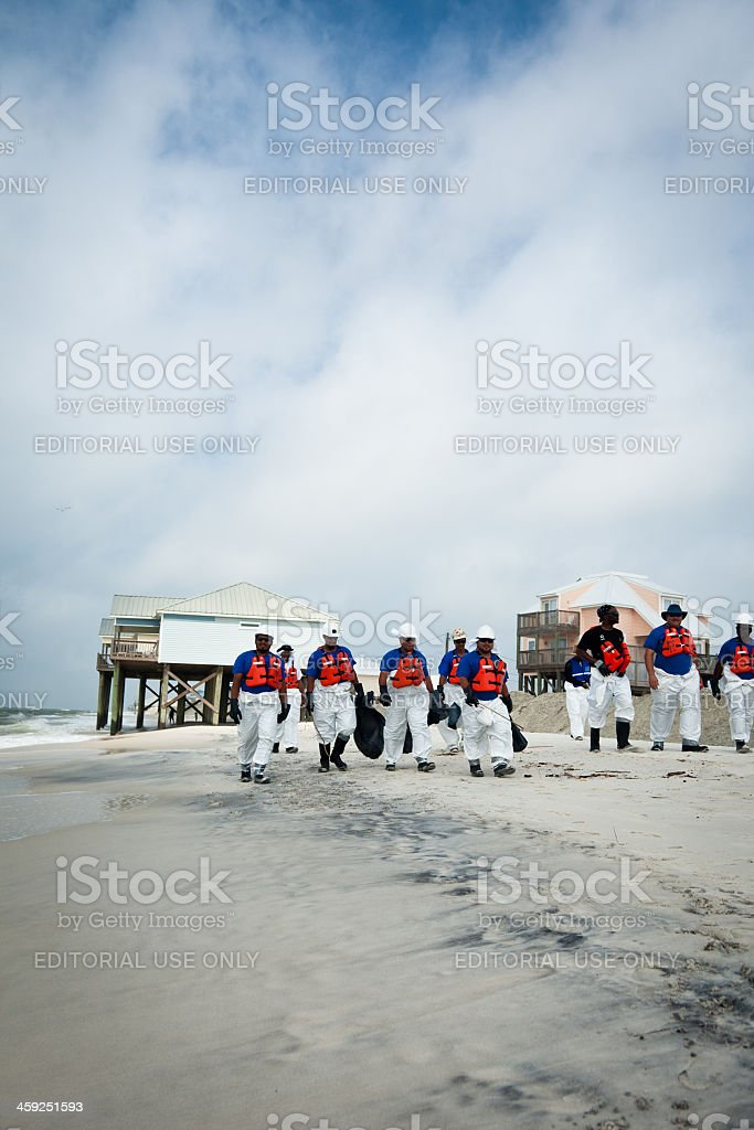 Workers cleaning up after the BP oil spill royalty-free stock photo