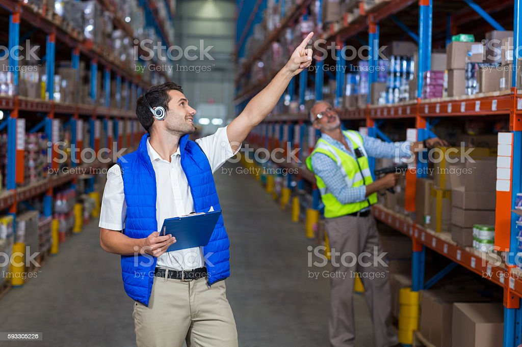 Workers colleague looking up stock photo
