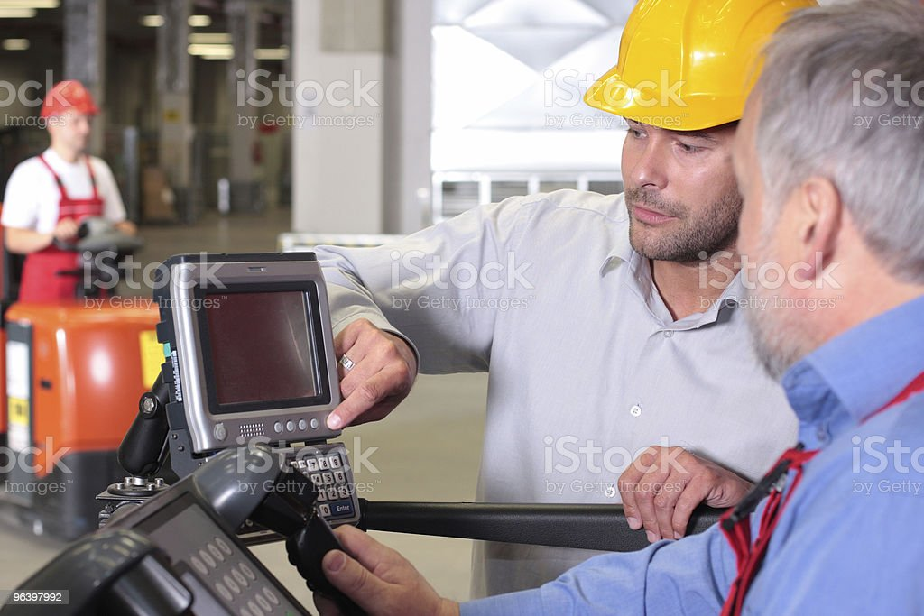 workers cooperation in warehouese stock photo