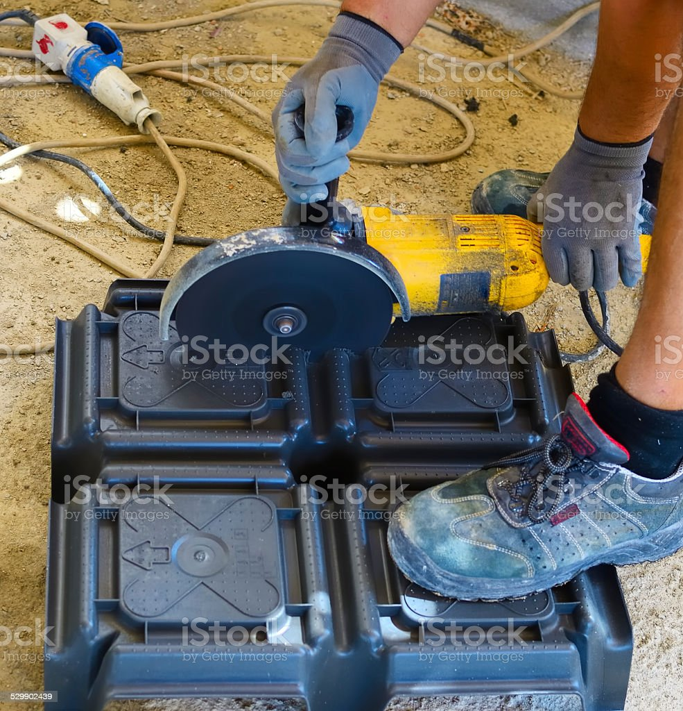 Workers cut a plastic dome with grinder stock photo