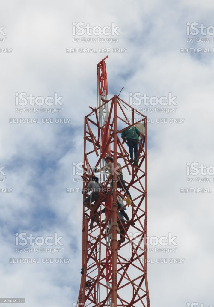 Workers demolition  telephone poles stock photo