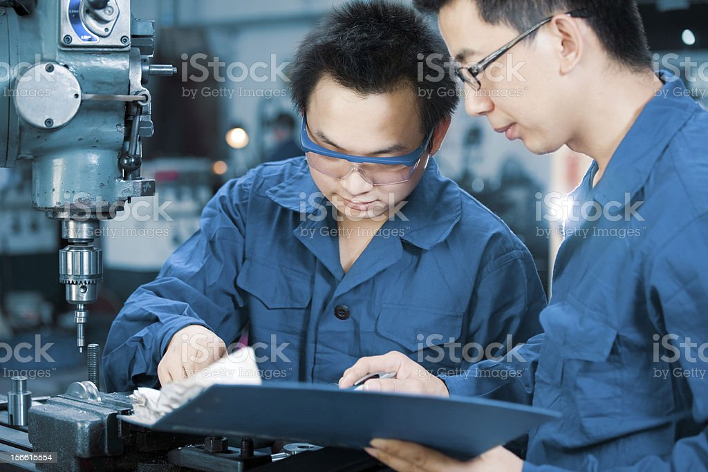 workers discussing plans stock photo