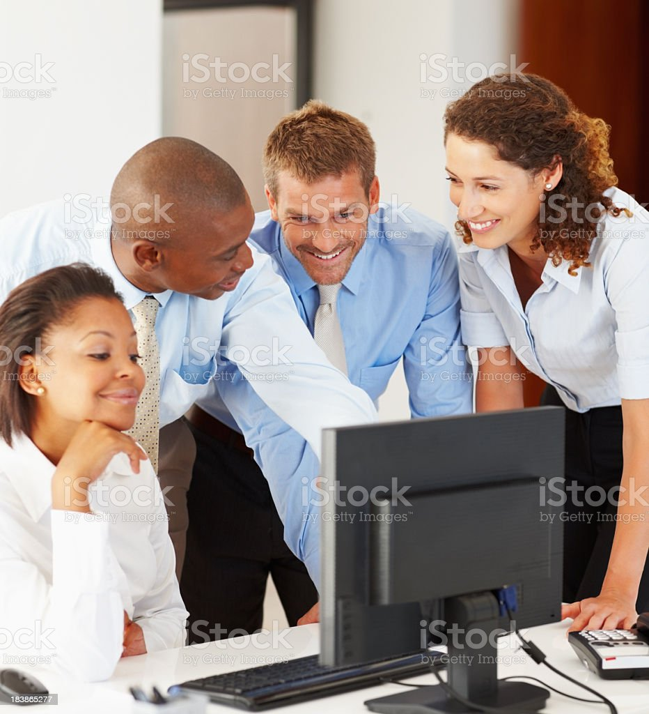 Workers discussing project on a computer royalty-free stock photo
