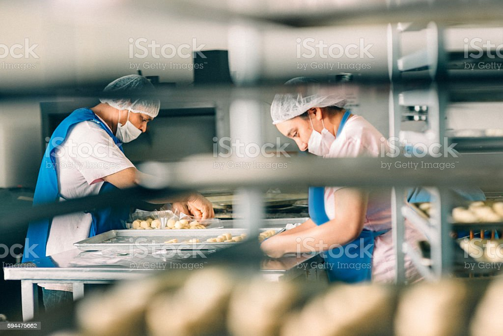 Workers filling orders at Bakery Workshop stock photo