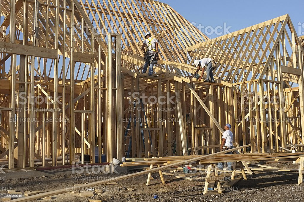 Workers framing a large home in Allen, Texas royalty-free stock photo