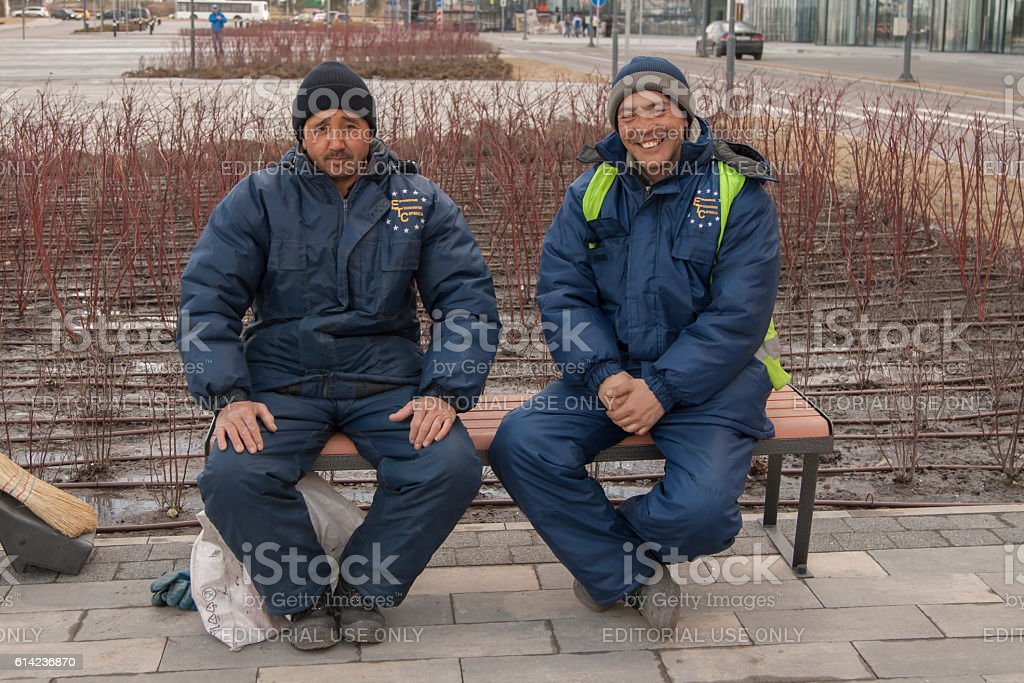 Workers from Middle Asia in Russia stock photo