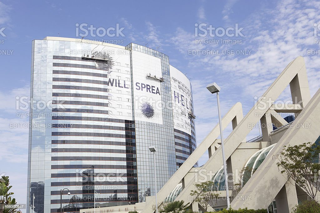 Workers Hanging Sign on Marriott Hotel for Comic Con 2013 stock photo