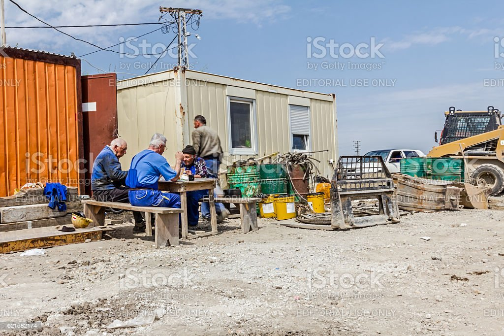 Workers having a meal break. People are eating among office. stock photo