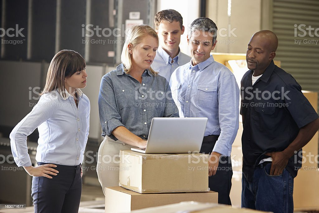 Workers having meeting in distribution warehouse stock photo